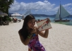 let my friend print and hold a sign with your logo or text on Boracay White Beach the most beautiful beach in the world